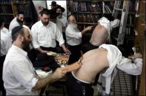 Men flog each other with leather whips on the eve of Kippur, usually in synagogue